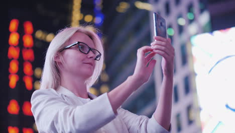 Woman-Tourist-Takes-Pictures-On-Times-Square-In-New-York-Tourism-And-Travel-In-The-Usa
