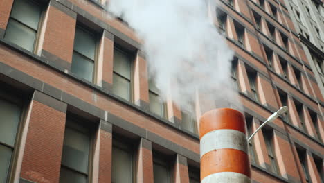 Pipe-With-Excess-Steam-From-The-Steam-System-Of-New-York-Bright-Orange-Striped---One-Of-The-Symbols-