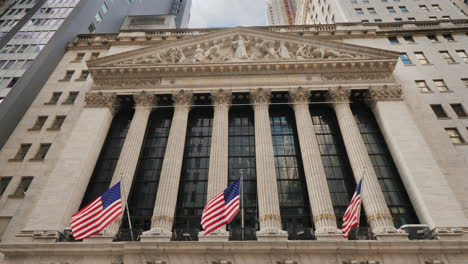 Stock-Exchange-Building-Located-On-Wall-Street-In-New-York-On-The-Building-Hangs-A-Poster