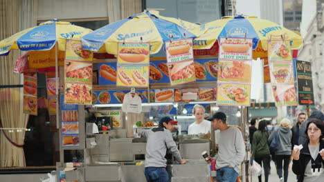 Fast-Food-Kiosks-On-Manhattan-Street-People-Pass-By