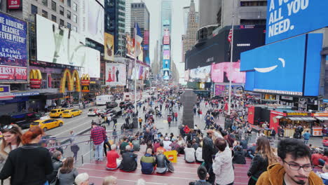 Times-Square-In-New-York-Many-Tourists-Admire-The-Bright-Lights-Of-Advertising-In-The-Heart-Of-The-U