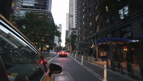 Yellow-New-York-Taxi-Rides-Through-The-Streets-Of-Manhattan