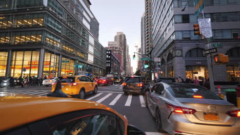 Riding-In-The-Evening-In-New-York-In-The-Famous-Yellow-Cab