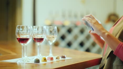 A-Woman-Photographs-A-Series-Of-Glasses-And-Beautiful-Candy-Wine-Tasting-With-Sweets-And-Wine-Tour