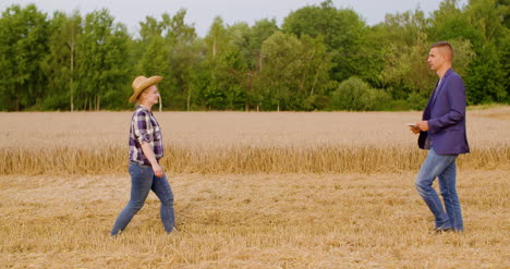 Young-Farmers-Discussing-At-Wheat-Field-8