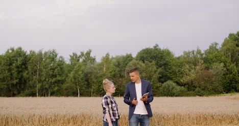 Young-Farmers-Discussing-At-Wheat-Field-10