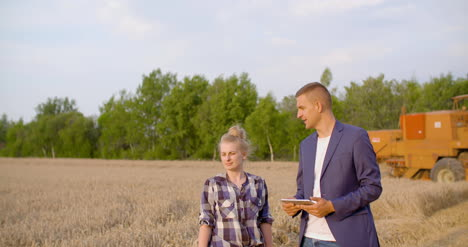 Young-Farmers-Discussing-At-Wheat-Field-13