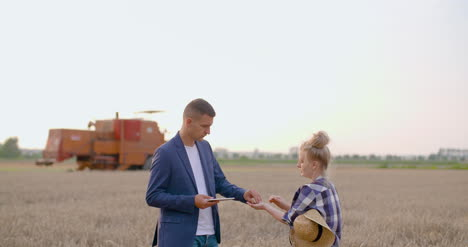 Young-Farmers-Discussing-At-Wheat-Field-15