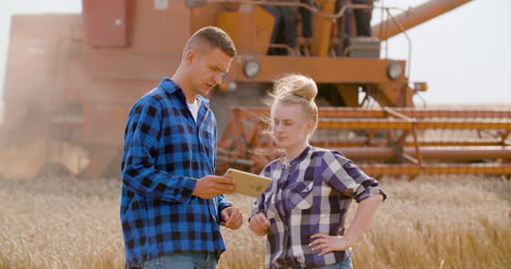 Young-Farmers-Discussing-At-Wheat-Field-17