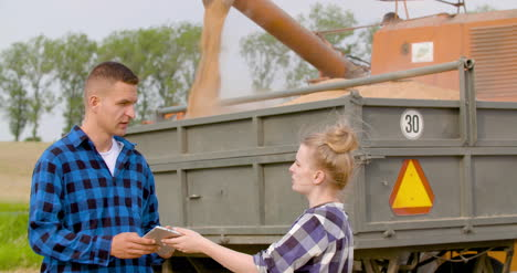 Young-Farmers-Discussing-At-Wheat-Field-18