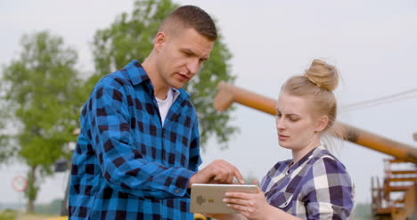 Young-Farmers-Discussing-At-Wheat-Field-19