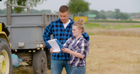 Young-Farmers-Discussing-At-Wheat-Field-20
