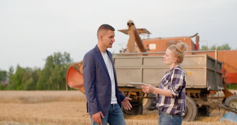 Young-Farmers-Discussing-At-Wheat-Field-21