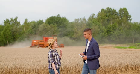 Young-Farmers-Discussing-At-Wheat-Field-24
