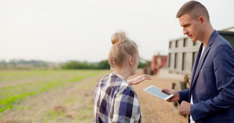 Young-Farmers-Discussing-At-Wheat-Field-27