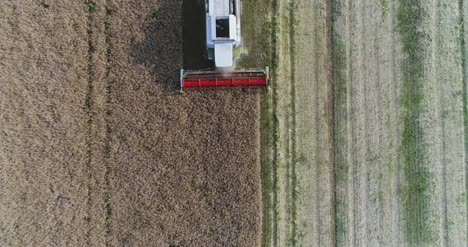 Machinery-Harvesting-Crops-On-Field-14