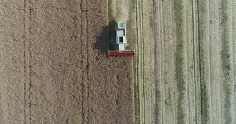 Machinery-Harvesting-Crops-On-Field-15