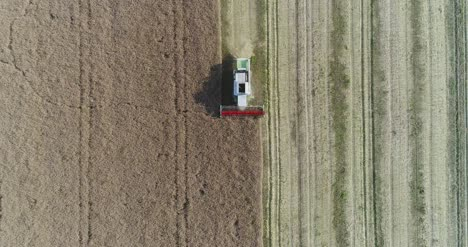 Machinery-Harvesting-Crops-On-Field-16