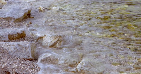 Soft-Wave-Of-The-Sea-On-The-Sea-Shore-Rocky-Beach-4