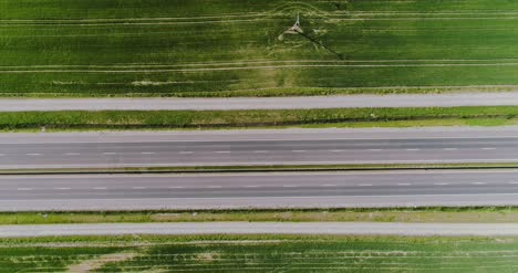 Car-Passing-Highway-Aerial-View-1