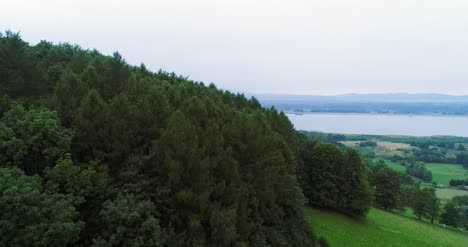 Aerial-View-Of-Forest-And-Lake-Small-Village