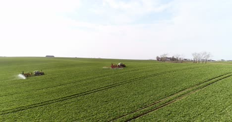 Tractor-Spray-Fertilize-On-Field-With-Chemicals-In-Agriculture-Field-48