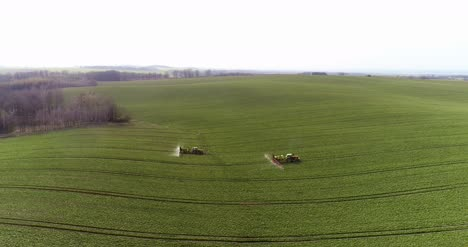 Tractor-Spray-Fertilize-On-Field-With-Chemicals-In-Agriculture-Field-5