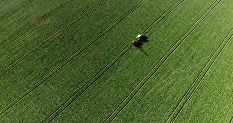 Tractor-Spray-Fertilize-On-Field-With-Chemicals-In-Agriculture-Field-7