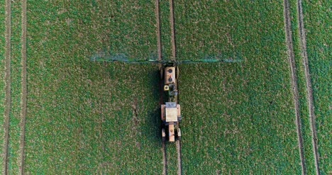 Tractor-Spray-Fertilize-On-Field-With-Chemicals-In-Agriculture-Field-10
