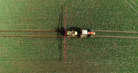 Tractor-Spray-Fertilize-On-Field-With-Chemicals-In-Agriculture-Field-11