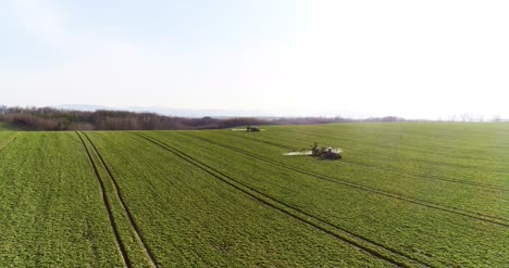 Tractor-Spray-Fertilize-On-Field-With-Chemicals-In-Agriculture-Field-14