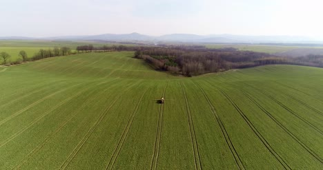 Tractor-Spray-Fertilize-On-Field-With-Chemicals-In-Agriculture-Field-15