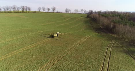 Tractor-Spray-Fertilize-On-Field-With-Chemicals-In-Agriculture-Field-16