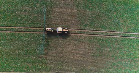 Tractor-Spray-Fertilize-On-Field-With-Chemicals-In-Agriculture-Field-17