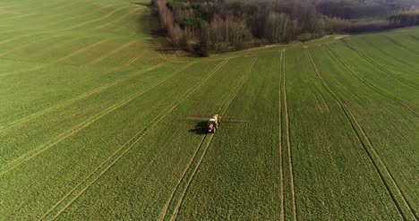Tractor-Spray-Fertilize-On-Field-With-Chemicals-In-Agriculture-Field-18