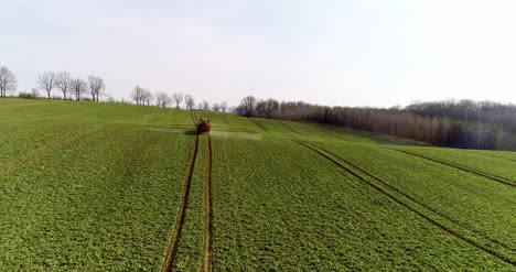Tractor-Spray-Fertilize-On-Field-With-Chemicals-In-Agriculture-Field-19