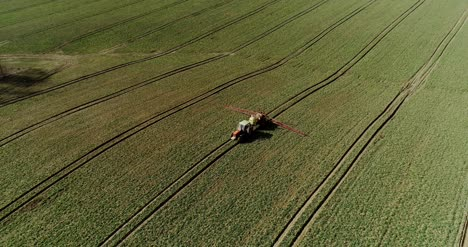 Tractor-Spray-Fertilize-On-Field-With-Chemicals-In-Agriculture-Field-22