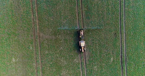 Tractor-Spray-Fertilize-On-Field-With-Chemicals-In-Agriculture-Field-26