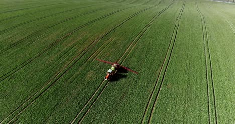 Tractor-Spray-Fertilize-On-Field-With-Chemicals-In-Agriculture-Field-30