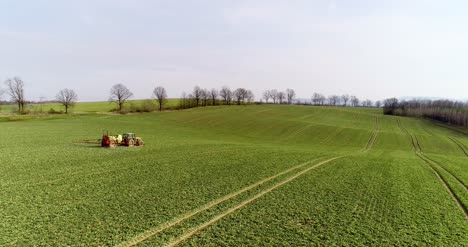 Tractor-Spray-Fertilize-On-Field-With-Chemicals-In-Agriculture-Field-31
