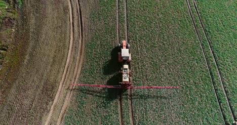 Tractor-Spray-Fertilize-On-Field-With-Chemicals-In-Agriculture-Field-33