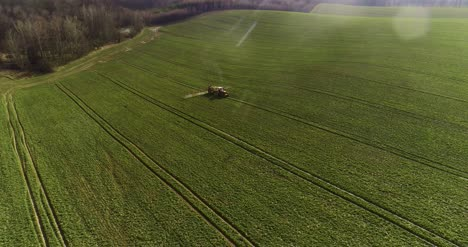 Tractor-Spray-Fertilize-On-Field-With-Chemicals-In-Agriculture-Field-37