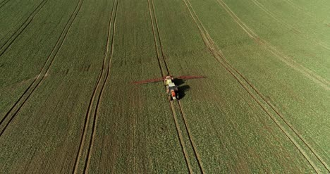 Tractor-Spray-Fertilize-On-Field-With-Chemicals-In-Agriculture-Field-38