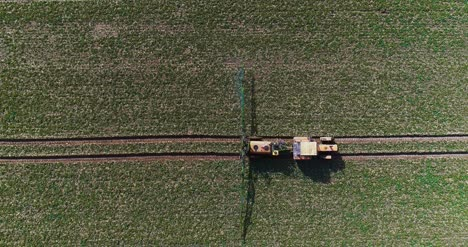 Tractor-Spray-Fertilize-On-Field-With-Chemicals-In-Agriculture-Field-44