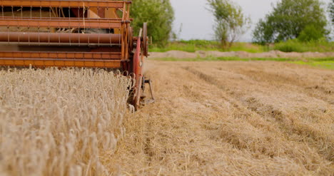 Combine-Harvester-Working-In-Agriculture-Field-2