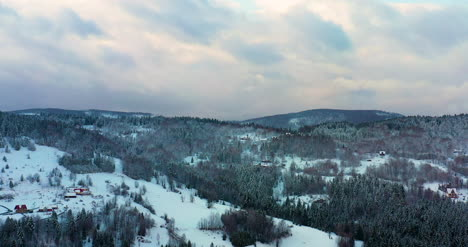 Sunset-At-Mountains-In-Winter-Aerial-View
