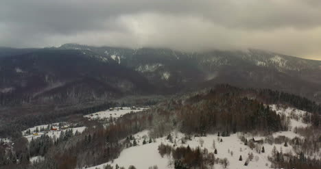 Aerial-View-Of-Forest-Covered-With-Snow-In-Mountains-6