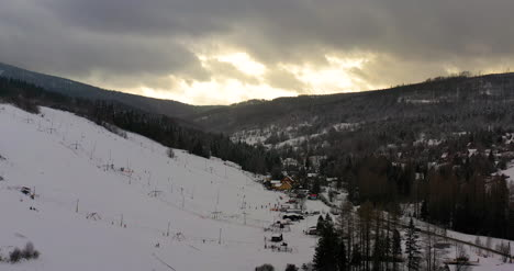 Forest-Covered-With-Snow-Aerial-View-Aerial-View-Of-Village-In-Mountains