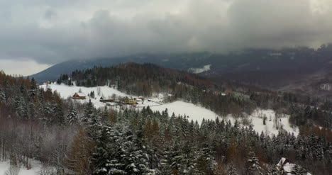 Forest-Covered-With-Snow-Aerial-View-Aerial-View-Of-Village-In-Mountains-12