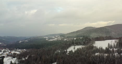 Forest-Covered-With-Snow-Aerial-View-Aerial-View-Of-Village-In-Mountains-15